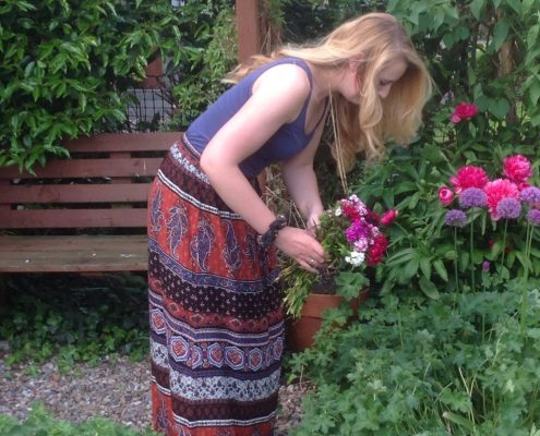 Izzy picking flowers