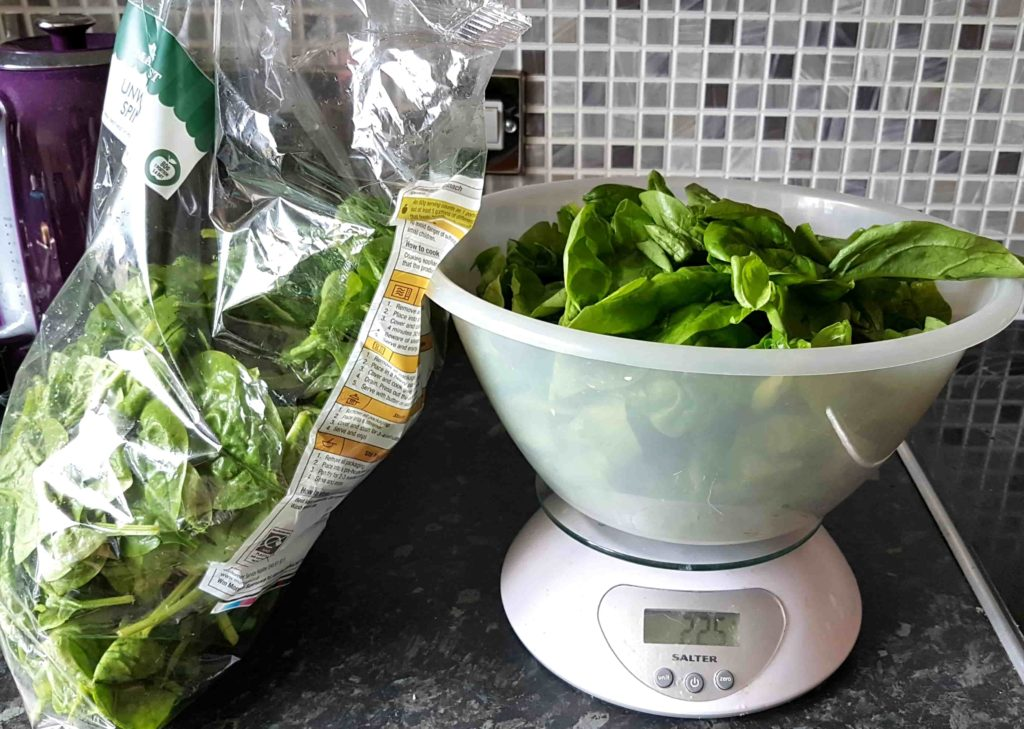 weighing spinach